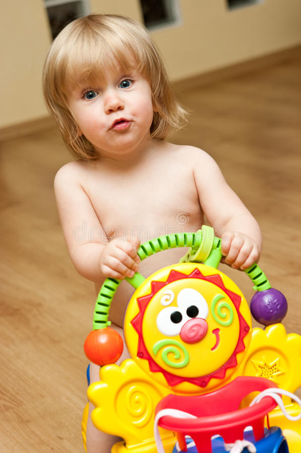 Download Cute Toddler Playing With Toy Stock Photo - Image: 22431264