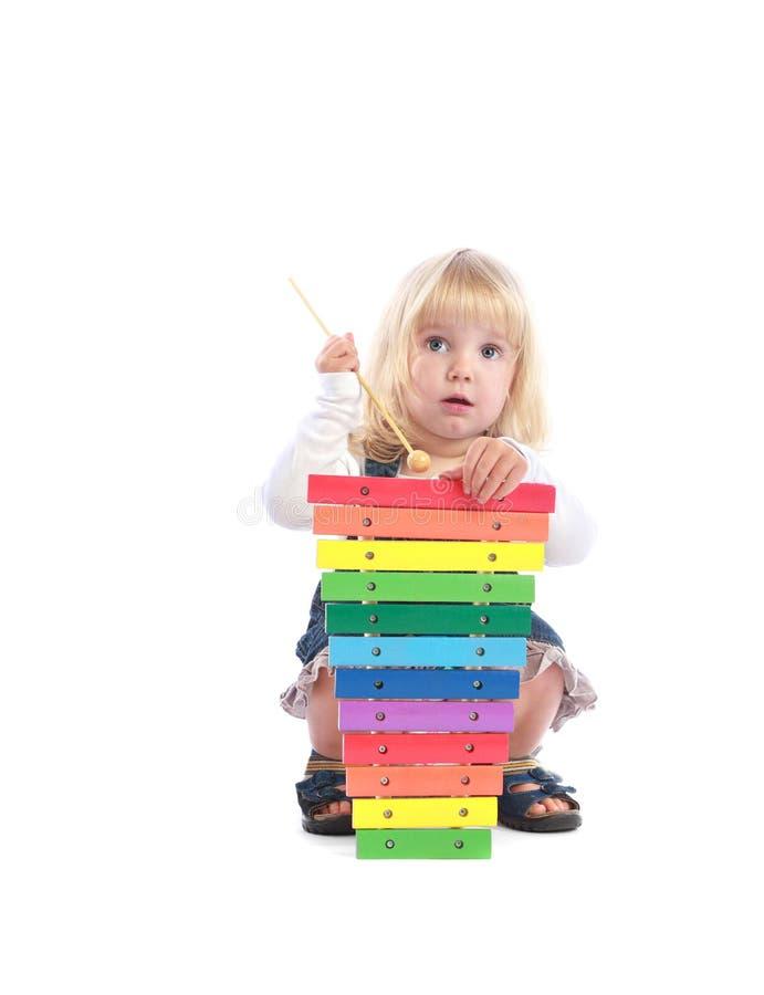 Cute toddler plays music stock photos