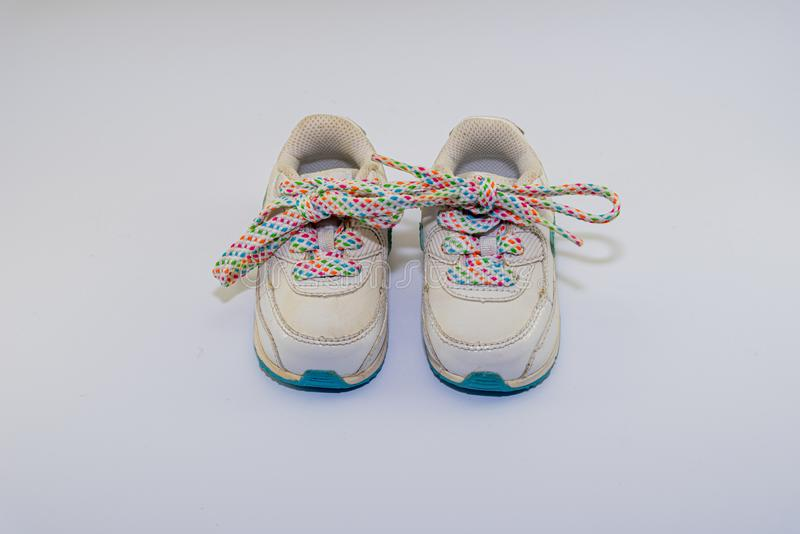 Cute toddler shoes with rainbow laces stock photography
