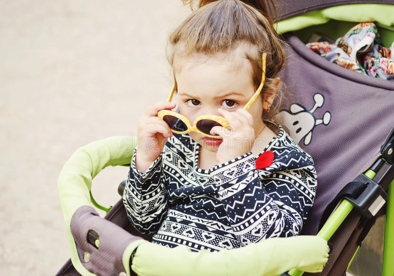Cute toddler in stroller stock photography