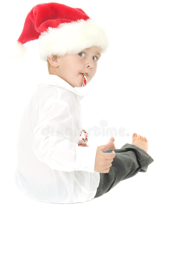 Download Cute Toddler Wearing Santa Hat Eats Candy Cane Stock Photo - Image: 10407512