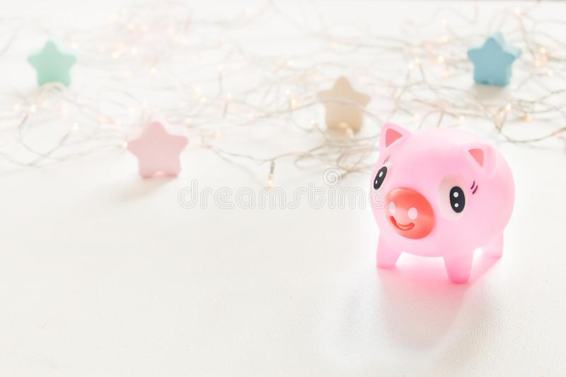 Cute toy Pink Piggy over bokeh lights and star background. Year of pig 2019. Pig symbol of year, Chinese Horoscope stock photography