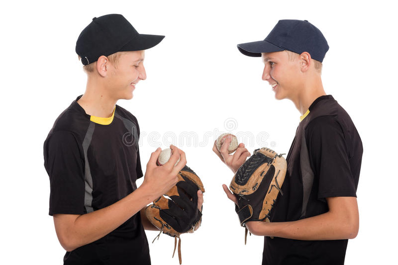 Cute twin brothers - young baseball players royalty free stock photography