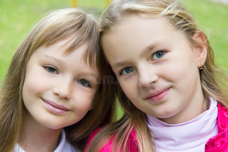 Cute two girls. Photo of two cute girls with long hairs royalty free stock photos