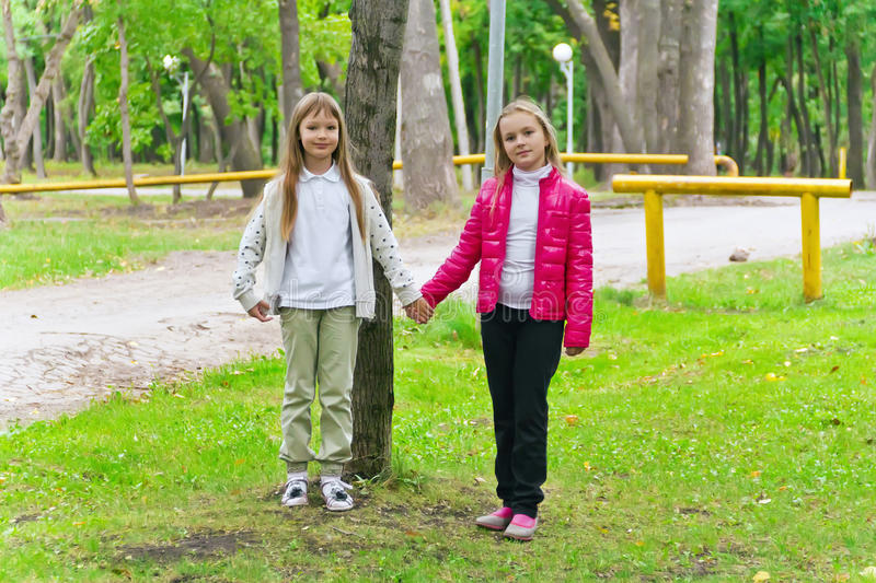 Cute two playing girls. Photo of two playing girls in summer stock images
