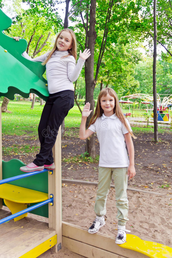 Cute two playing girls. Photo of two playing girls in summer stock photography