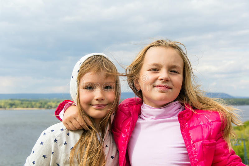 Cute two playing girls. Photo of two playing girls in summer royalty free stock image
