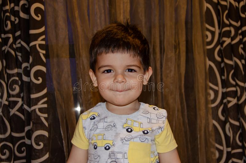 Cute two years old boy making funny faces early development concept, portrait, face expressions stock photo