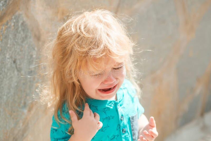 Cute unhappy baby boy crying royalty free stock photos