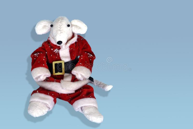 Cute white rat in a red Santa Claus costume. Year of the rat. Greeting card with New Year 2020 Symbol of 2020 on the Eastern stock photography