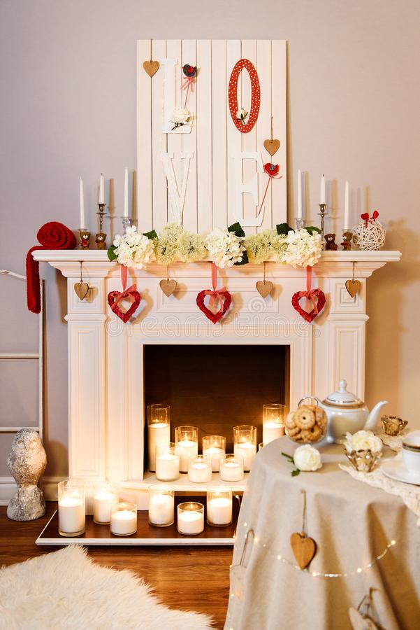 Cute white and red room with lots of heart-shaped decoration stock photography