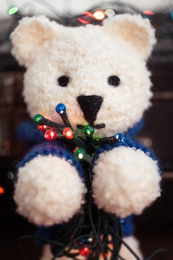 Cute white teddy bear with Christmas lights stock photos