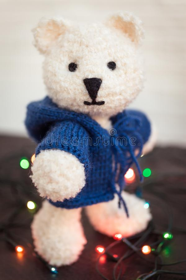 Cute white teddy bear with Christmas lights royalty free stock photos