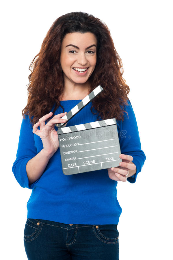 Cute Woman In Blue Attire Holding Clapperboard Royalty Free Stock Photos