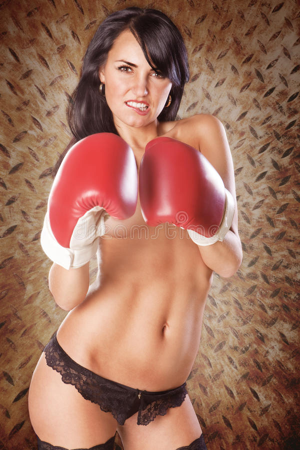 Cute woman boxing topless wearing black panties royalty free stock images