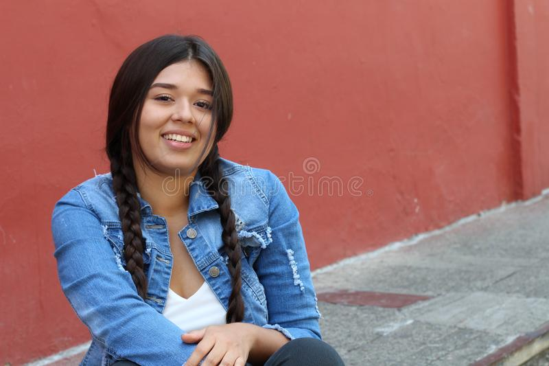 Cute woman with braided hair royalty free stock photo