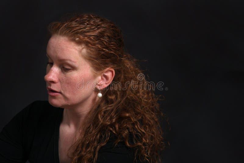 Cute woman close up portrait, on black background stock photo