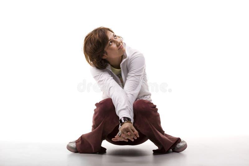 Cute woman crouching stock photos