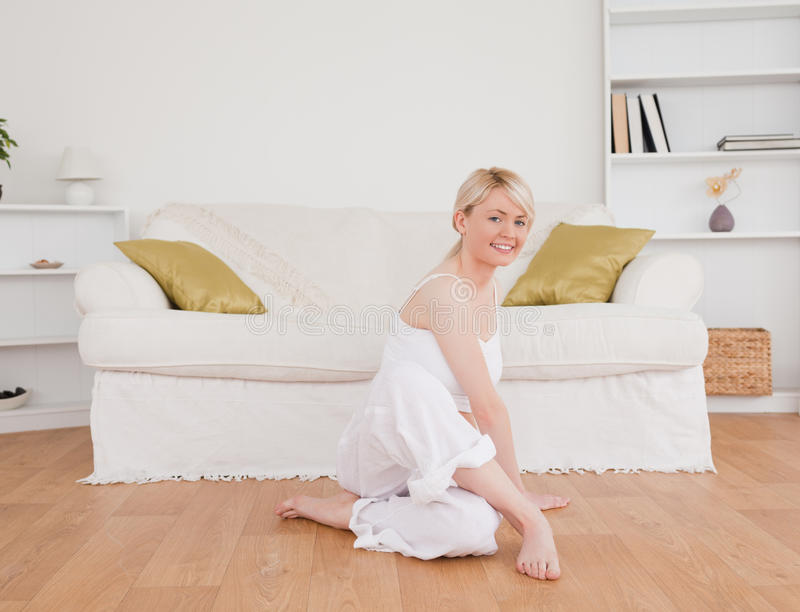 Cute woman doing fitness exercises royalty free stock photo