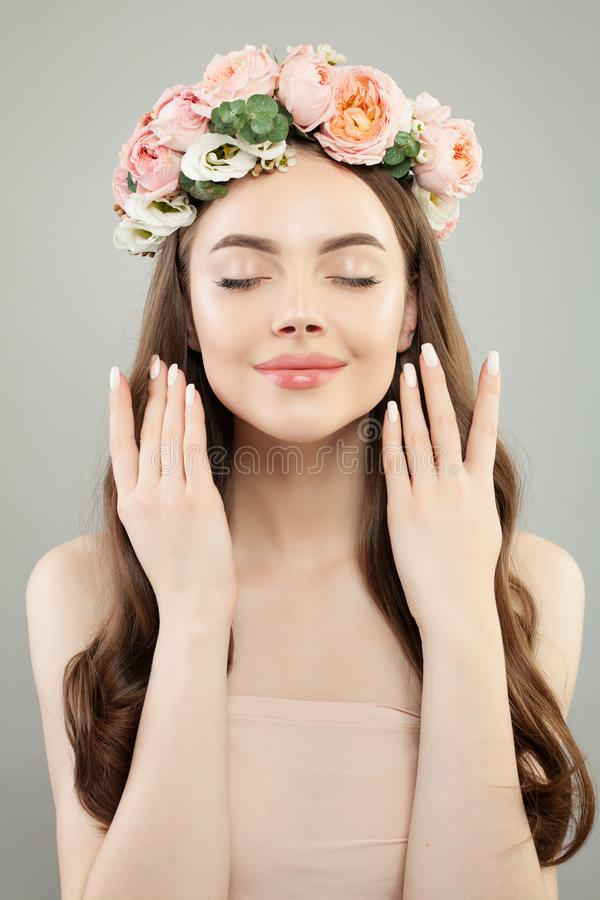 Cute woman face. Beautiful model with flowers royalty free stock photo