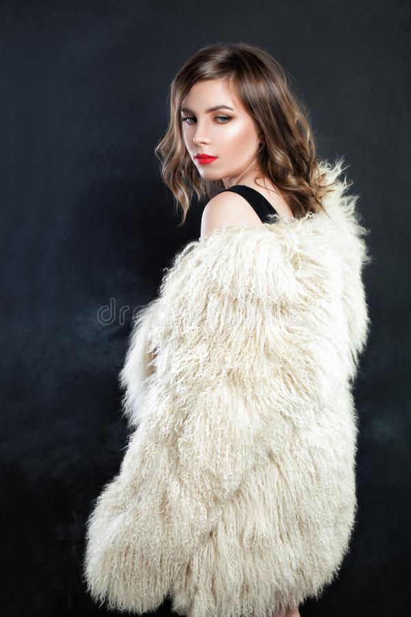 Cute Woman Fashion Model in Autumn or Winter Fur Coat royalty free stock photos