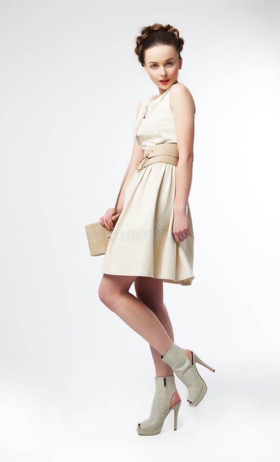 Cute woman fashion model in retro dress posing royalty free stock photography