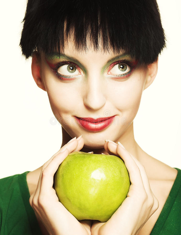 Cute woman holding green apple royalty free stock images