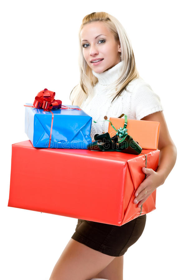 Cute woman holding present at christmas time stock photo