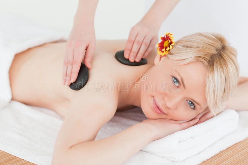 Cute Woman Receiving A Massage With Hot Stones Royalty Free Stock Photo