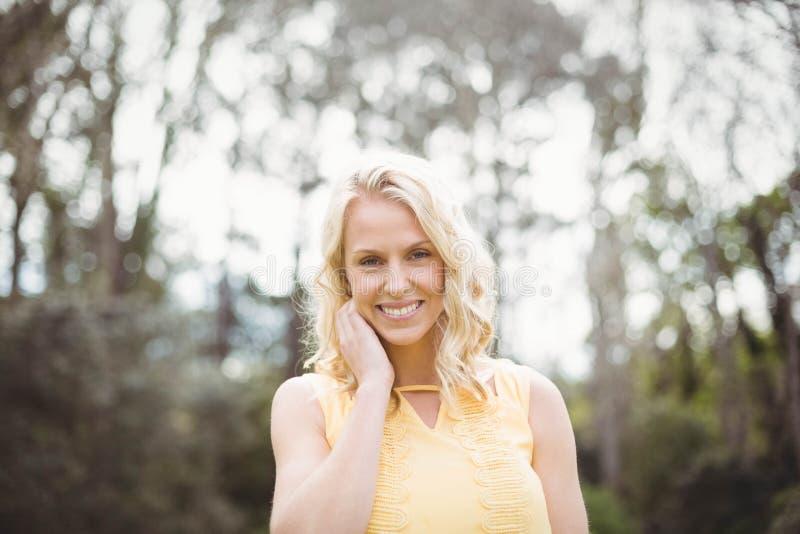 Cute woman smiling at camera stock photos