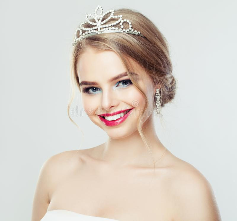Cute woman smiling. Pretty model with wedding hair and diamonds jewelry portrait stock photography