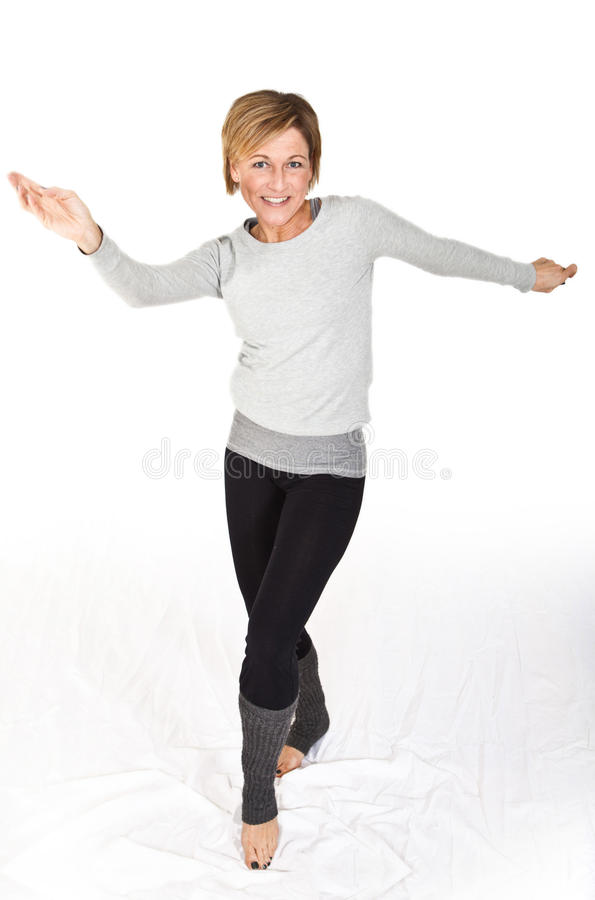 Cute woman standing and dancing on white background royalty free stock images