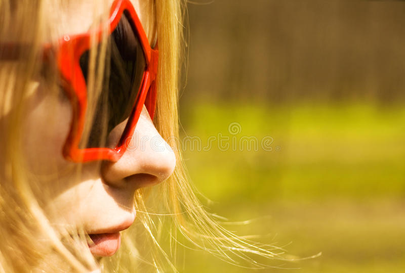 Cute woman in star-shaped sun glasses. Copy space stock image