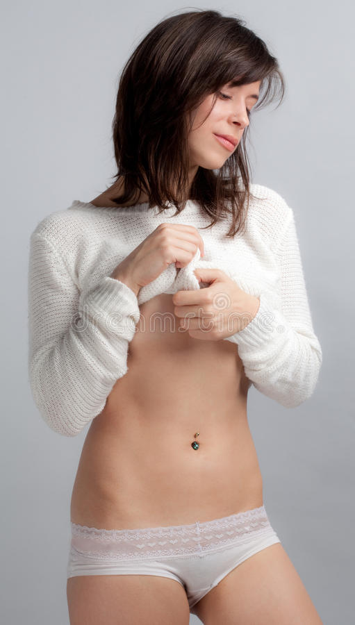 Cute Woman in Sweater and Panties stock photo
