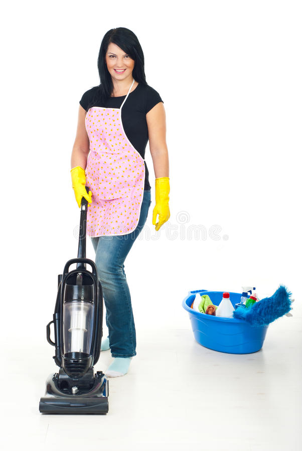 Cute woman using vacuum cleaner royalty free stock image