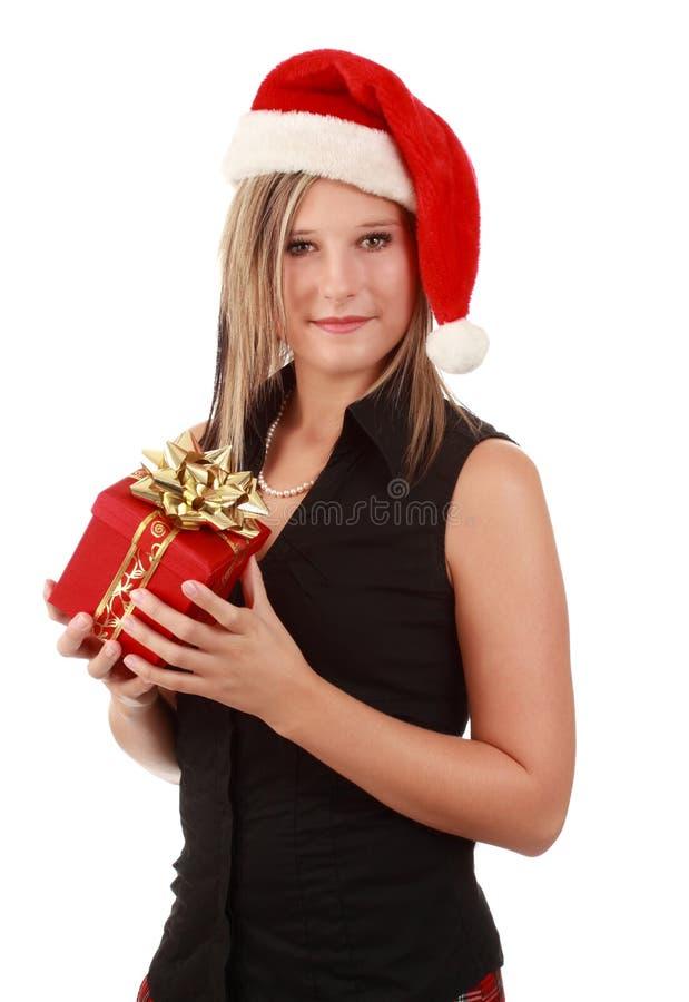 Cute woman wearing santa hat stock photo