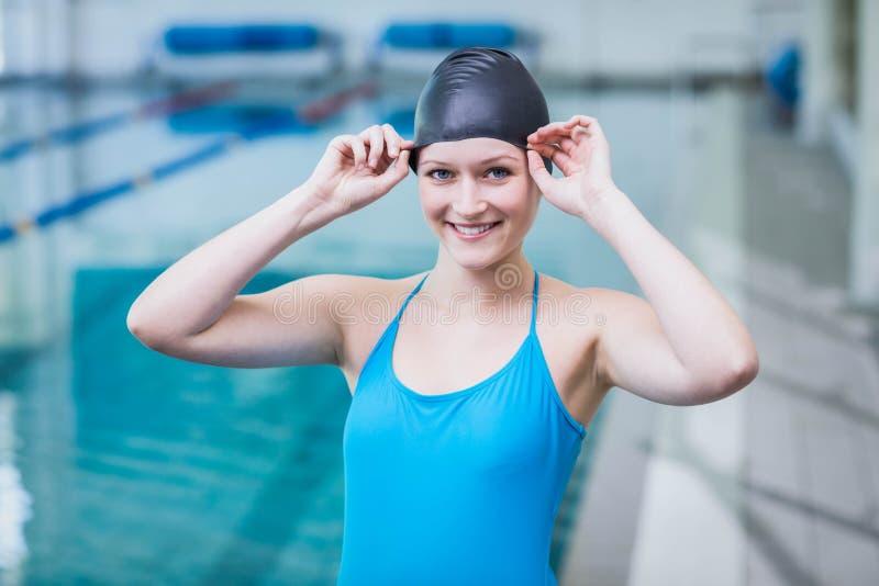 Cute woman wearing swim cap. At the pool stock photos