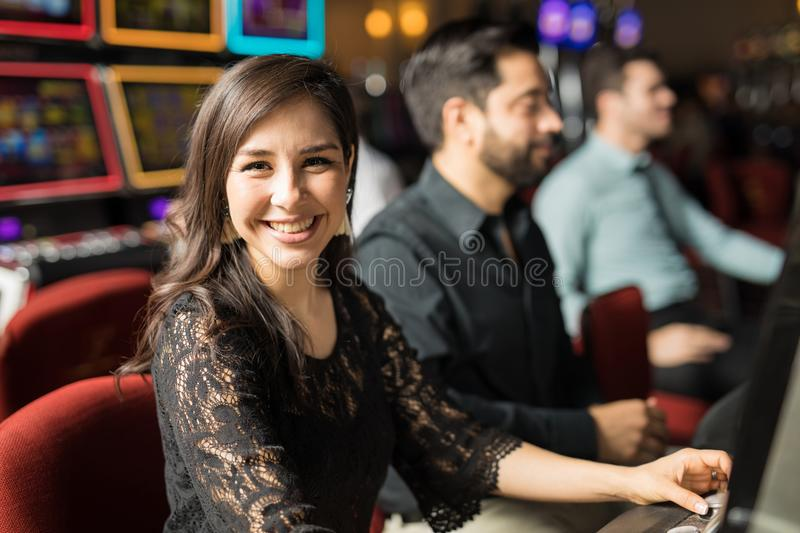 Cute woman winning in a casino stock image