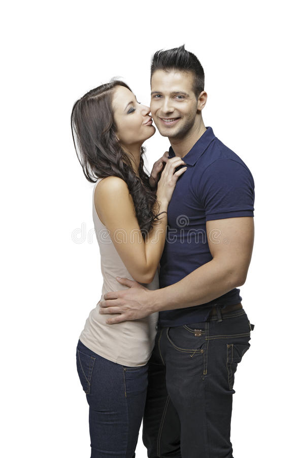 Cute women kissing her boyfriend royalty free stock images
