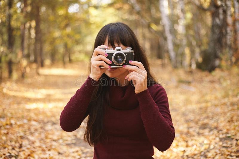 Cute women with vintage camera stock images