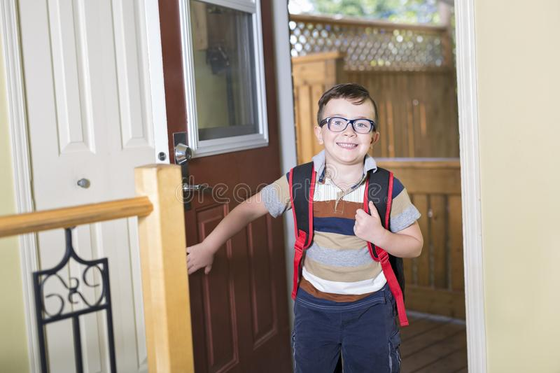 Cute 6 year old Caucasian boy inside home preschool royalty free stock images