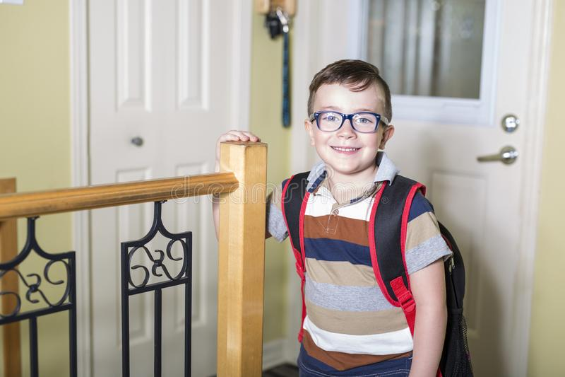 Cute 6 year old Caucasian boy inside home preschool royalty free stock photos