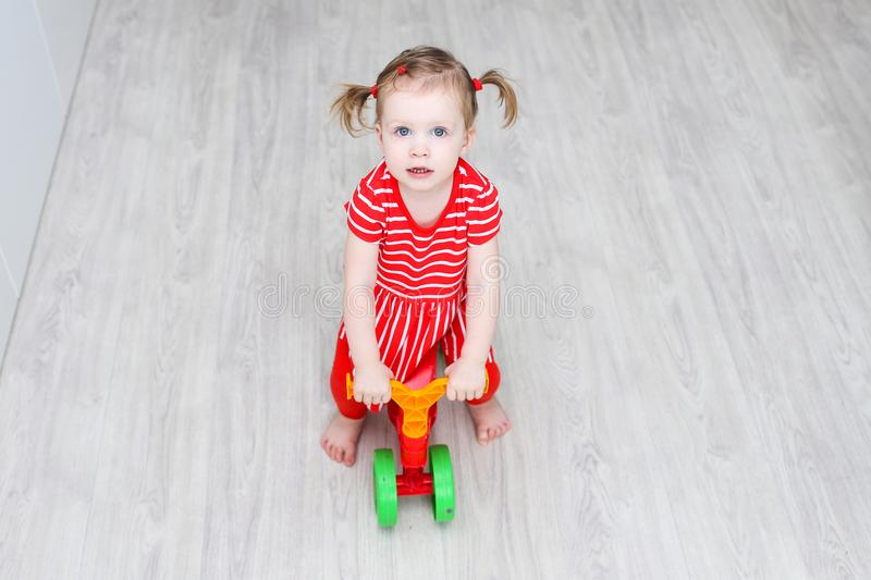 Cute 1 years little girl on run bike royalty free stock images