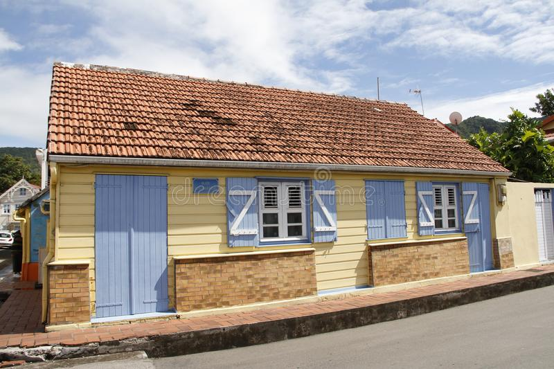 Cute yellow home on Allee des Arlesiens in Les Anses d`Arlet village, Grand Anse, Martinique. French West Indies, France stock photos