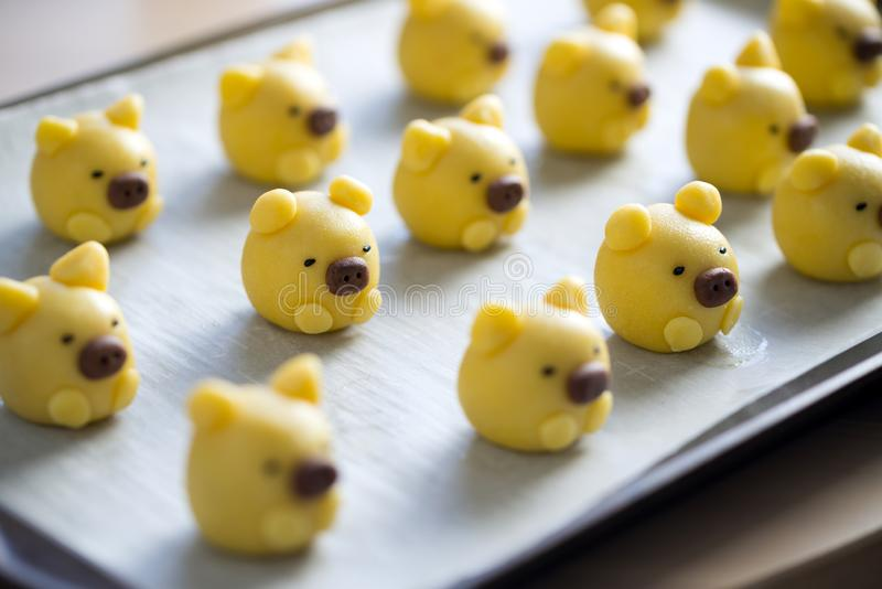 Cute yellow pig cookie on tray. Ready to be baked royalty free stock photo