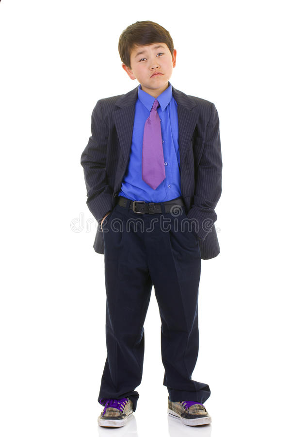 Cute young asian boy in suit and tie isolated royalty free stock images