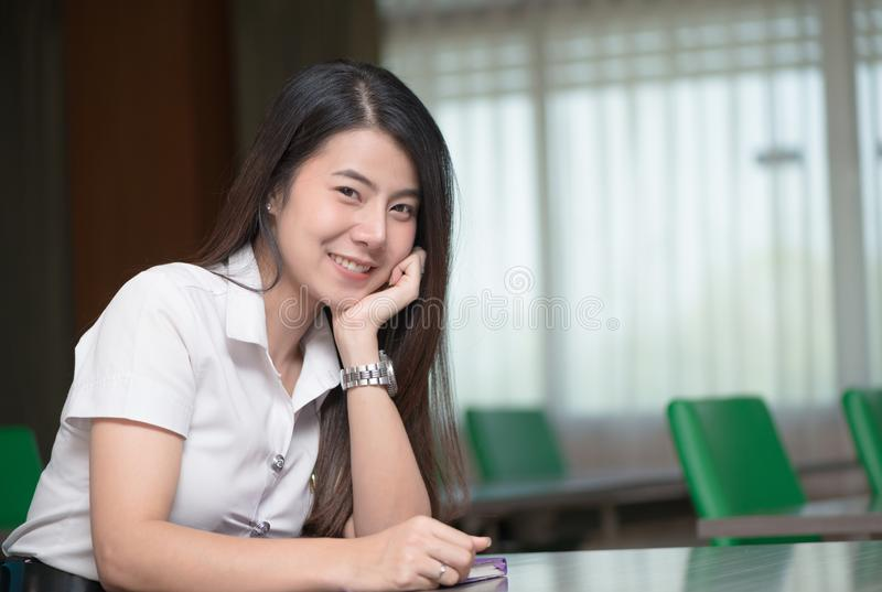 Cute young asian student in uniform royalty free stock photo