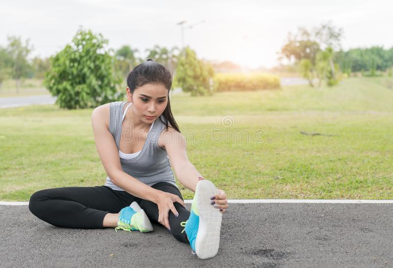 Cute young asian woman stretching after run on track stock photos