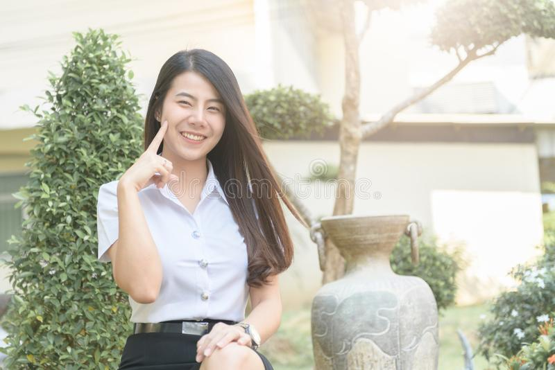 Cute young asian woman in uniform student smile stock photography