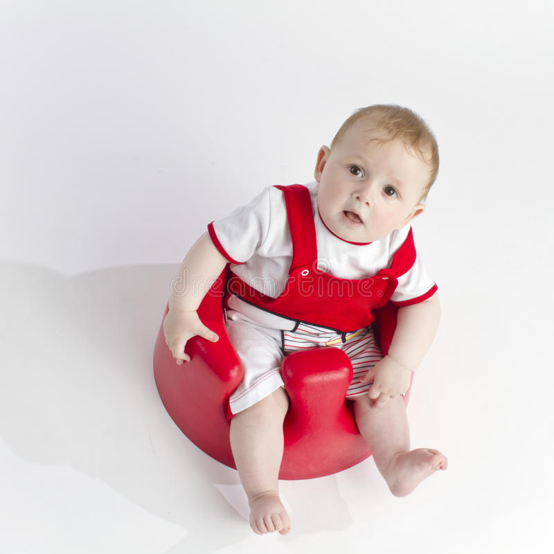 Cute Young Baby In Chair Royalty Free Stock Photos
